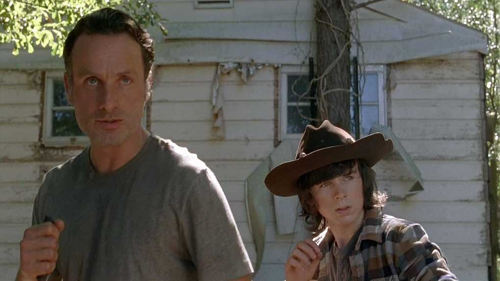 Rick and Carl defend against walkers
