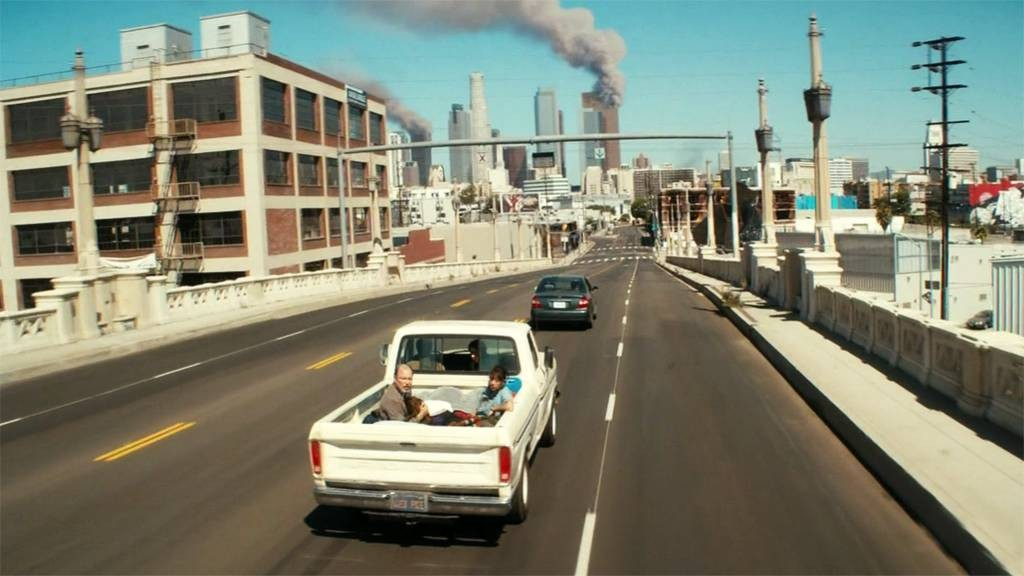 Los Angeles burns in the background as the characters from Fear the Walking Dead drive west.