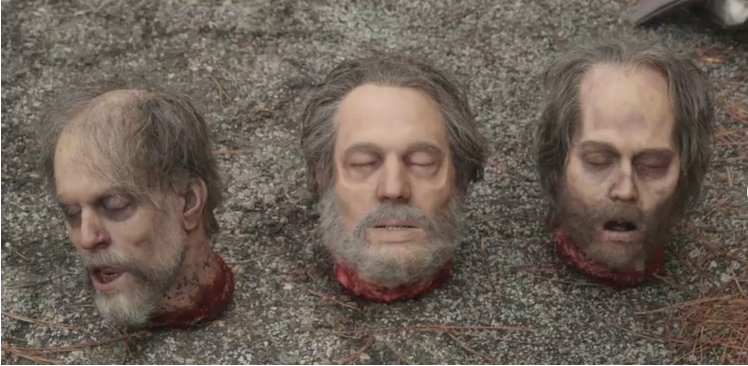 The middle head is Greg Nicotero and the right one is Johnny Depp.
