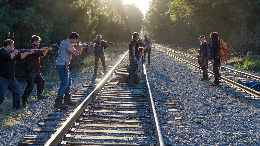 D (Austin Amelio), Eugene Porter (Josh McDermitt), Rosita Espinosa (Christian Serratos) and Daryl Dixon (Norman Reedus). Train tracks are bad luck. Photo by Gene Page/AMC